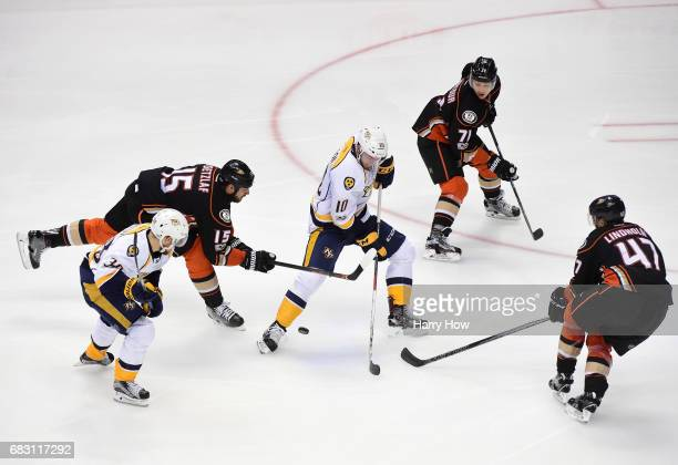 Colton Sissons of the Nashville Predators skates the puck into the offensive zone against Ryan Getzlaf Brandon Montour and Hampus Lindholm of the...