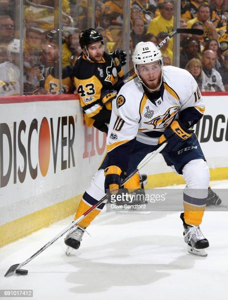 Colton Sissons of the Nashville Predators skates with the puck away from Conor Sheary of the Pittsburgh Penguins during the second period of Game Two...