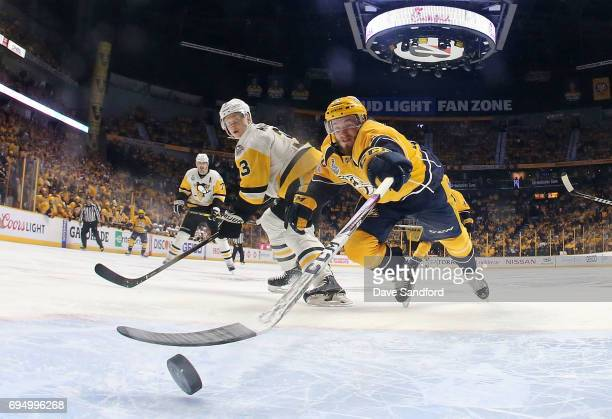 Colton Sissons of the Nashville Predators taps in the rebound after the whislte was blown as Olli Maatta of the Pittsburgh Penguins looks on in the...