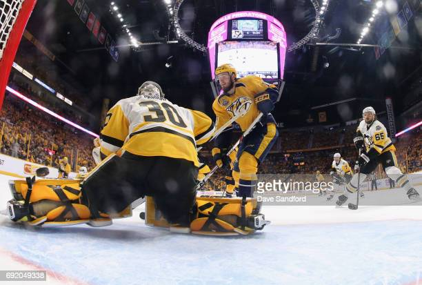 Colton Sissons of the Nashville Predators watches the puck go over goaltender Matt Murray of the Pittsburgh Penguins on a goal by teammate Roman Josi...
