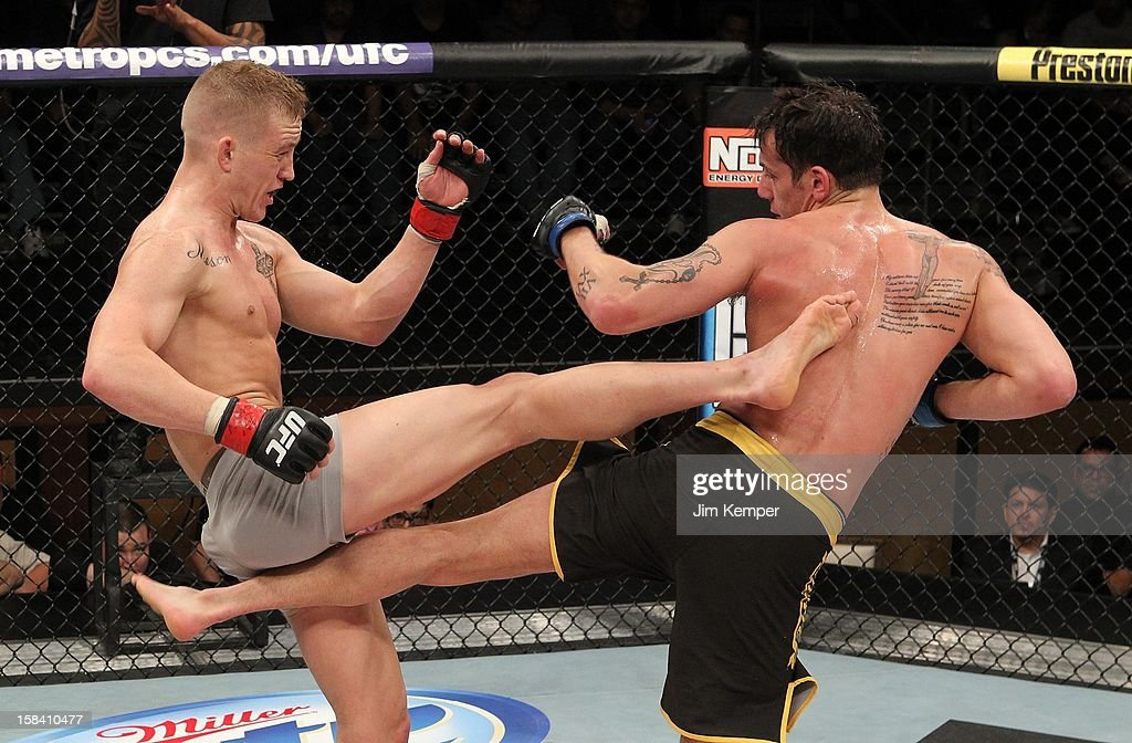 Colton Smith and <a gi-track='captionPersonalityLinkClicked' href=/galleries/search?phrase=Mike+Ricci&family=editorial&specificpeople=209305 ng-click='$event.stopPropagation()'>Mike Ricci</a> exchange kicks during their lightweight fight at the TUF 16 Finale on December 15, 2012 at the Joint at the Hard Rock in Las Vegas, Nevada.