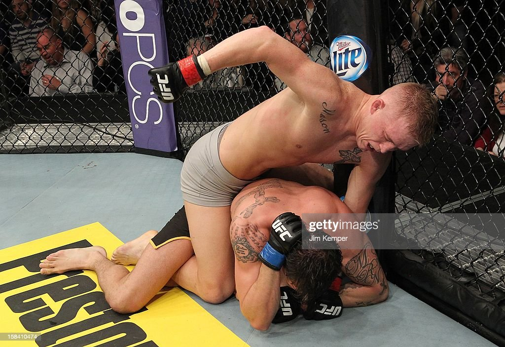 Colton Smith (top) punches <a gi-track='captionPersonalityLinkClicked' href=/galleries/search?phrase=Mike+Ricci&family=editorial&specificpeople=209305 ng-click='$event.stopPropagation()'>Mike Ricci</a> during their lightweight fight at the TUF 16 Finale on December 15, 2012 at the Joint at the Hard Rock in Las Vegas, Nevada.