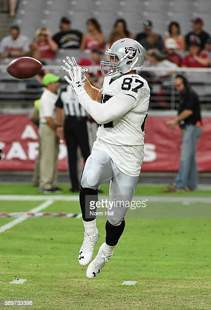 Colton Underwood of the Oakland Raiders catches a pass during warm ups prior to a preseason game against the Arizona Cardinals at University of...