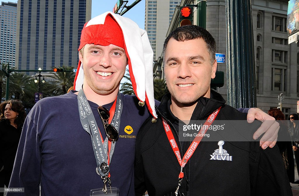 Colts placekicker Adam Vinatieri (R), a 4-time Super Bowl champion, awards a pair of Super Bowl tickets to lucky fan Jim Burnett on behalf of Barclaycard US and the NFL Extra Points Credit Card on January 31, 2013 in New Orleans, Louisiana.