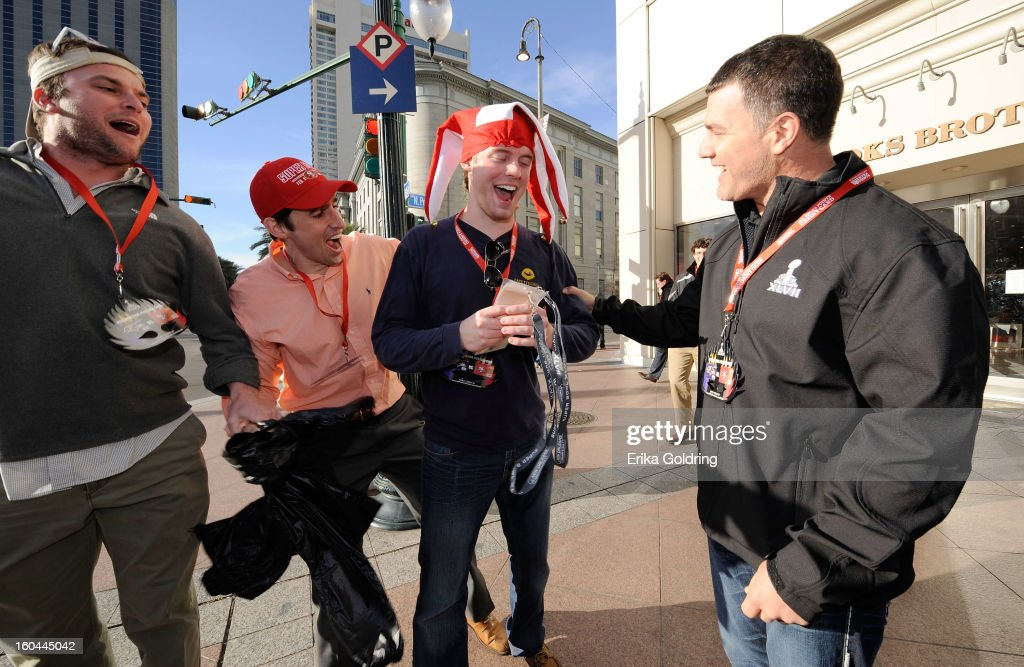 Colts placekicker Adam Vinatieri (R), a 4-time Super Bowl champion, awards a pair of Super Bowl tickets to lucky fans (L-R) Jourdan Cancienne, Sean Moore and Jim Burnett on behalf of Barclaycard US and the NFL Extra Points Credit Card on January 31, 2013 in New Orleans, Louisiana.