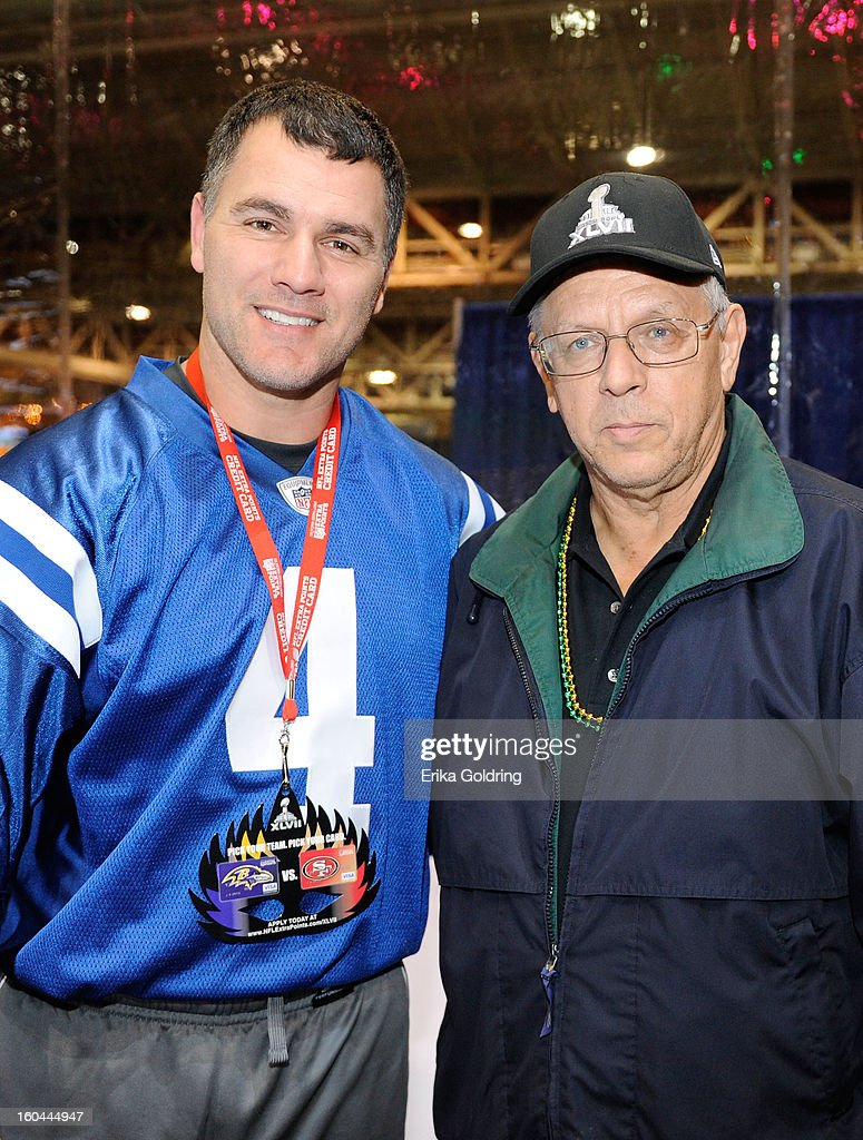 Colts placekicker Adam Vinatieri (L), a 4-time Super Bowl champion, poses with NFL Extra Points Credit Card member and winner of Super Bowl XLVII tickets Bill Brooks (R) as he kicks for a good cause. Vinatieri has teamed up with Barclaycard US, the issuer of the card, to donate $10,000 for the Brees Dream Foundation on January 31, 2013 in New Orleans, Louisiana.