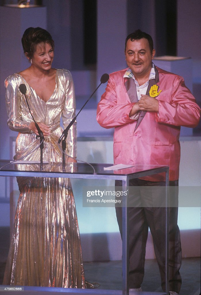 <a gi-track='captionPersonalityLinkClicked' href=/galleries/search?phrase=Coluche&family=editorial&specificpeople=1722539 ng-click='$event.stopPropagation()'>Coluche</a> with French actress Nathalie Baye at the Cesar awards ceremonies (French film awards).