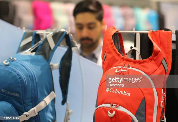Columbia Sportwear Co backpacks hang on display during the Outdoor Retailer Summer Market Show in Salt Lake City Utah US on Saturday July 29 2017...