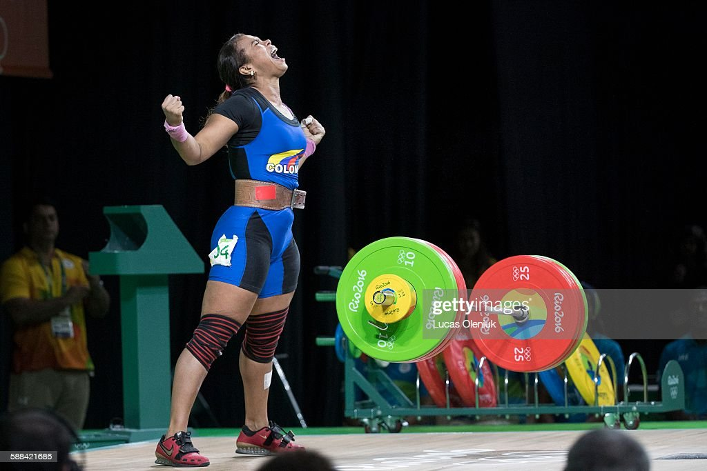 Columbian weightlifter Leidy Yessenia Solis Arboleda reacted after lifting 143kg in the clean and jerk portion of the women's 69kg weightlifting...