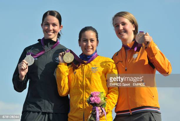 Columbia's Mariana Pajon celebrates gold in the BMX with silver medalist New Zealand's Sarah Walker and bronze medalist The Netherland's Laura...