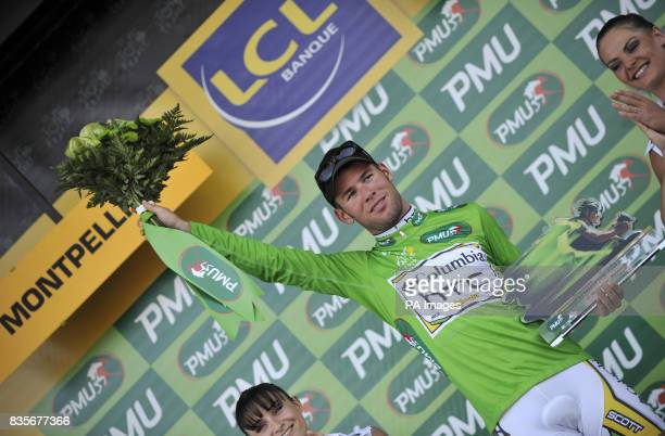Columbia's Mark Cavendish celebrates retaining the Green Jersey in the Team Time Trial during the fourth stage of the Tour de France around...