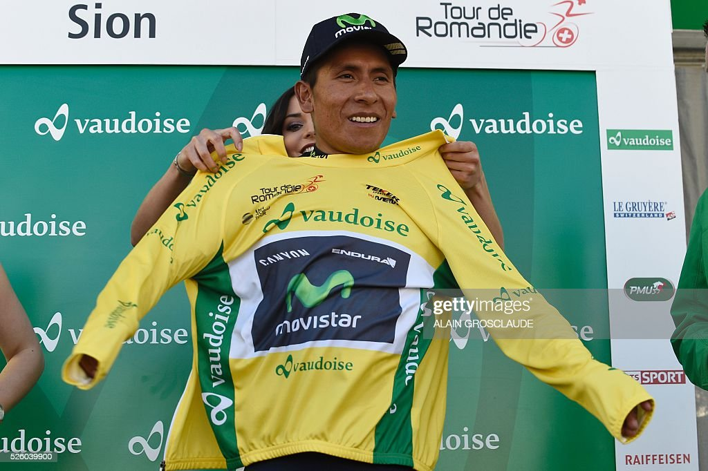 Columbia's Nairo Alexander Quintana wears the overall yellow jersey during podium ceremony after the fourth stage of the 70th Tour de Romandie UCI World Tour, a 15 km individual time-trial in Sion, on April 29, 2016, in Lausanne. / AFP / Alain Grosclaude