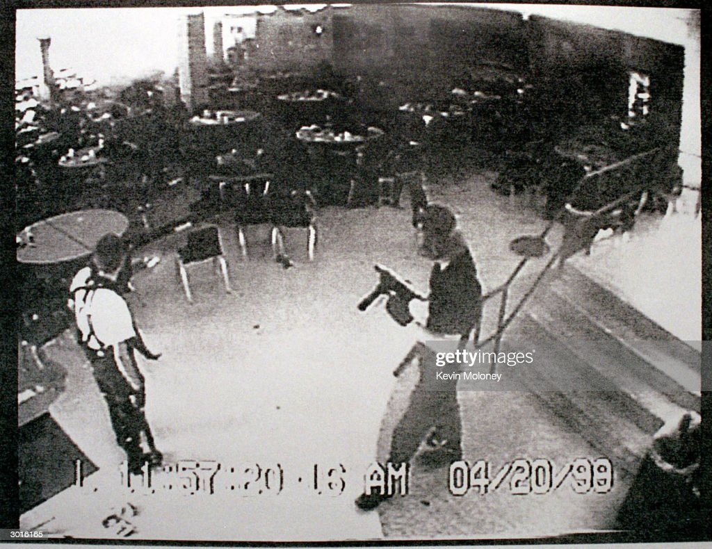 Columbine high school shooters Eric Harris (L) and Dylan Klebold appear in this video capture of a surveillance tape released by the Jefferson County Sheriff's Department in the cafeteria at Columbine High School April 20, 1999 in Littleton, CO during their shooting spree which killed 13 people.