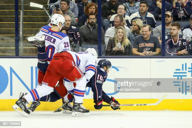 Columbus Blue Jackets center Alexander Wennberg falls to the ice chasing a loose puck during the third period in a game between the Columbus Blue...