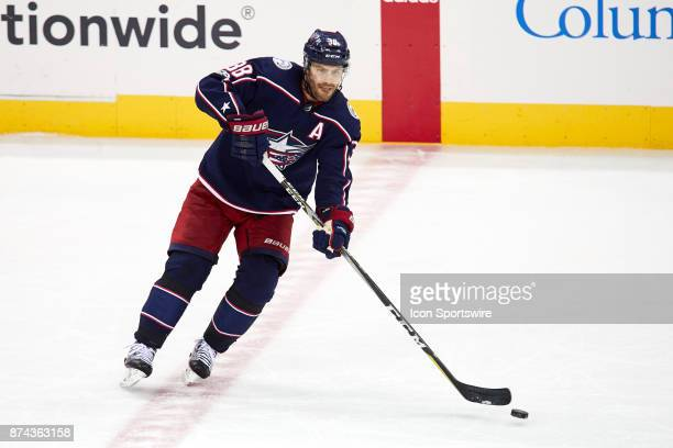 Columbus Blue Jackets center Boone Jenner controls the puck during a game between the Columbus Blue Jackets and the Caroling Hurricanes on November...