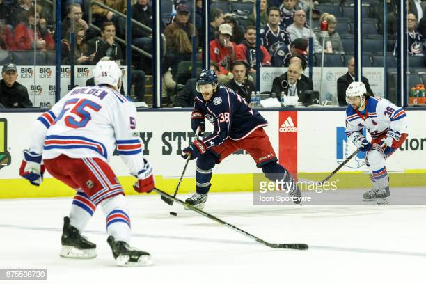 Columbus Blue Jackets center Boone Jenner controls the puck during the first period in a game between the Columbus Blue Jackets and the New York...