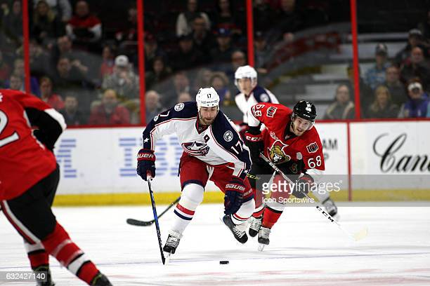 Columbus Blue Jackets Center Brandon Dubinsky makes his way down the ice with Ottawa Senators Left Wing Mike Hoffman in pursuit in a game between the...