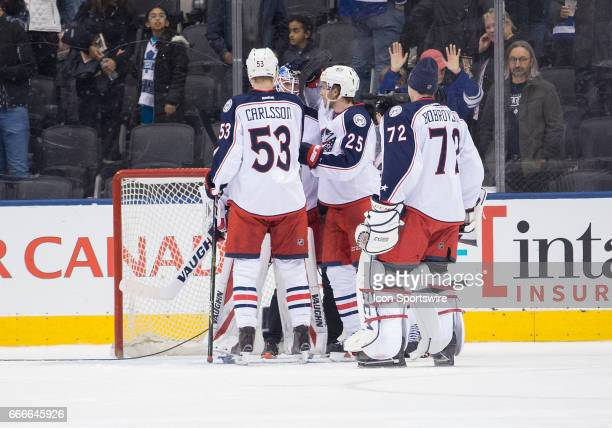 Columbus Blue Jackets defenceman Gabriel Carlsson celebrates the win with Columbus Blue Jackets goalie Joonas Korpisalo at the end of the third...