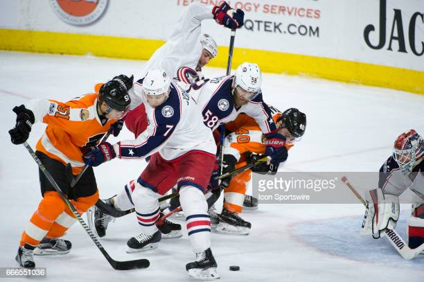 Columbus Blue Jackets Defenceman Jack Johnson keeps the puck from Philadelphia Flyers Center Valtteri Filppula in front of the net in the second...