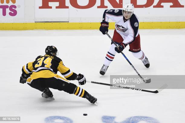 Columbus Blue Jackets defenseman Zach Werenski pass the puck Pittsburgh Penguins Left Wing Tom Kuhnhackl during the first period in Game One of the...