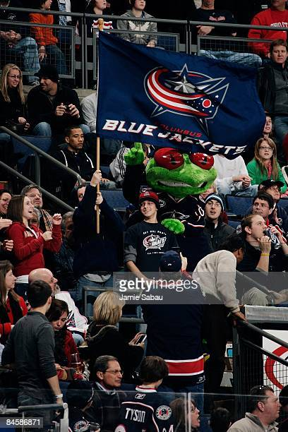 Columbus Blue Jackets fans and team mascot Stinger pass around a team flag during a game against the Ottawa Senators on January 30 2009 at Nationwide...