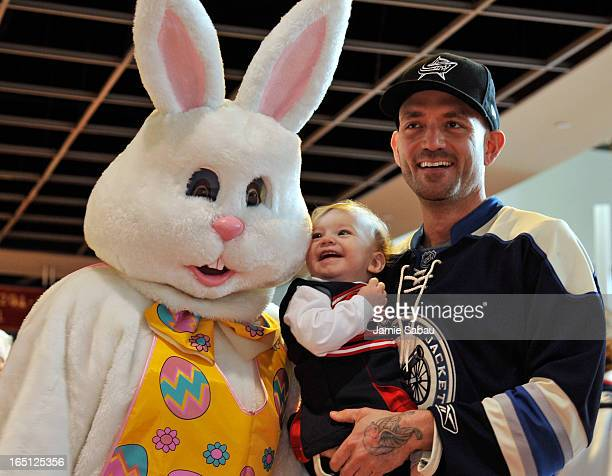Columbus Blue Jackets fans pose for a photo with the Easter Bunny before the game between the Anaheim Ducks and the Columbus Blue Jackets on March 31...