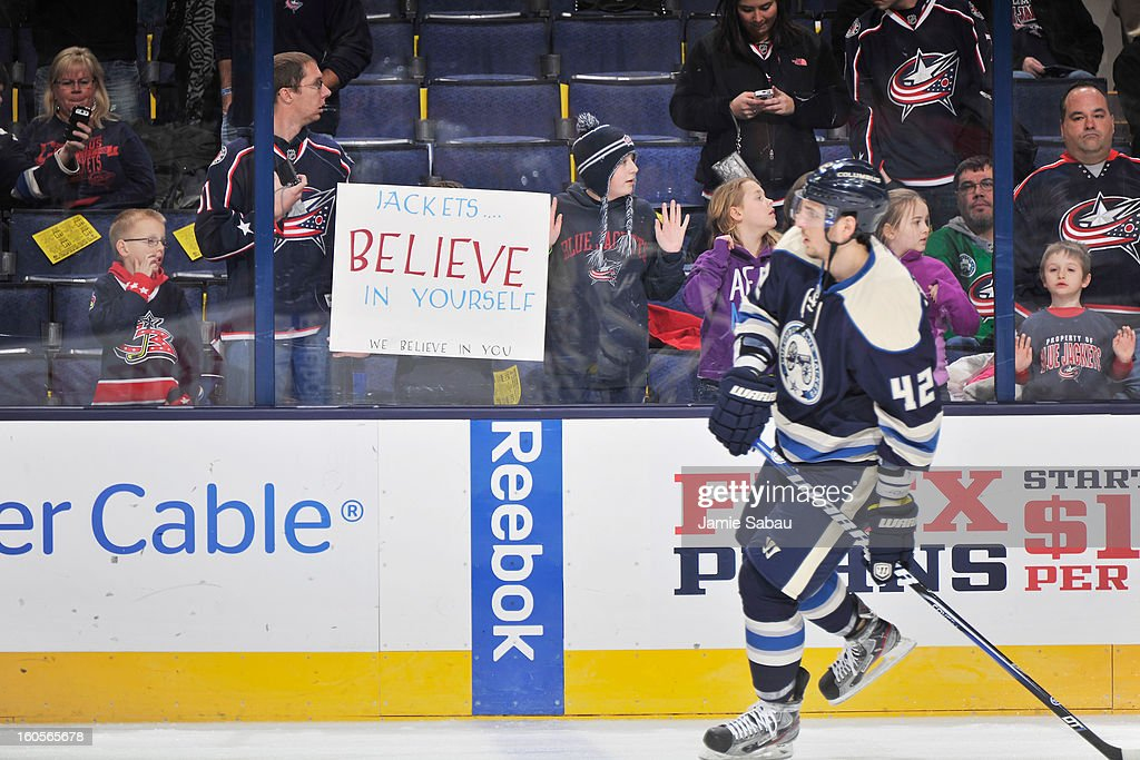 Columbus Blue Jackets fans show their support for their team as Artem Anisimov #42 of the Columbus Blue Jackets skates by before a game against the Detroit Red Wings on February 2, 2013 at Nationwide Arena in Columbus, Ohio. Columbus defeated Detroit 4-2.