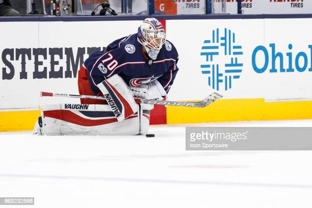 Columbus Blue Jackets goalie Joonas Korpisalo stretches during warmups before a game between the Columbus Blue Jackets and the Los Angeles Kings on...