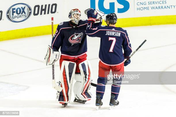 Columbus Blue Jackets goalie Sergei Bobrovsky and Columbus Blue Jackets defenseman Jack Johnson celebrate after the game between the Columbus Blue...