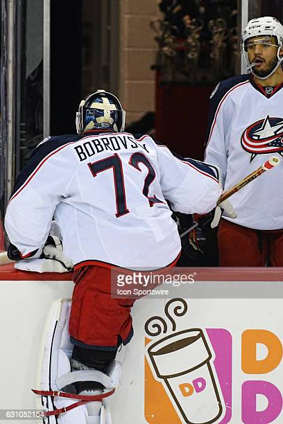 Columbus Blue Jackets goalie Sergei Bobrovsky climbs over the bench after being pulled in the third period against the Washington Capitals on January...