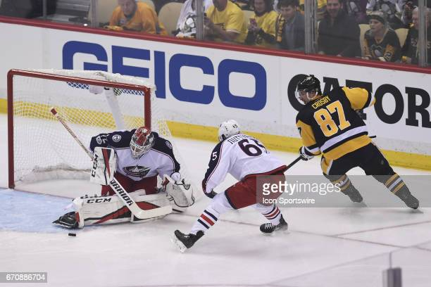Columbus Blue Jackets goalie Sergei Bobrovsky makes a pad save on Pittsburgh Penguins Center Sidney Crosby as Columbus Blue Jackets defenseman Markus...