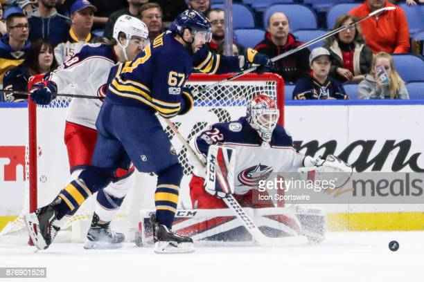Columbus Blue Jackets Goalie Sergei Bobrovsky tracks loose puck in front of Blue Jackets goal as Buffalo Sabres Left Wing Benoit Pouliot looks for...