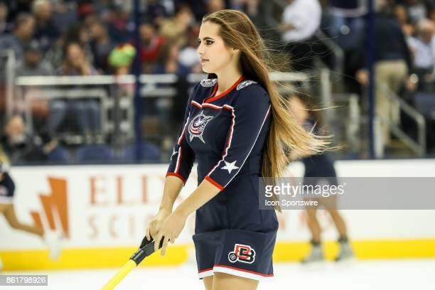 Columbus Blue Jackets ice girl skate up the ice during the first period in a game between the Columbus Blue Jackets and the New York Rangers on...