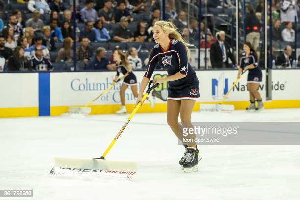 Columbus Blue Jackets ice girls skate up the ice during the first period in a game between the Columbus Blue Jackets and the New York Rangers on...