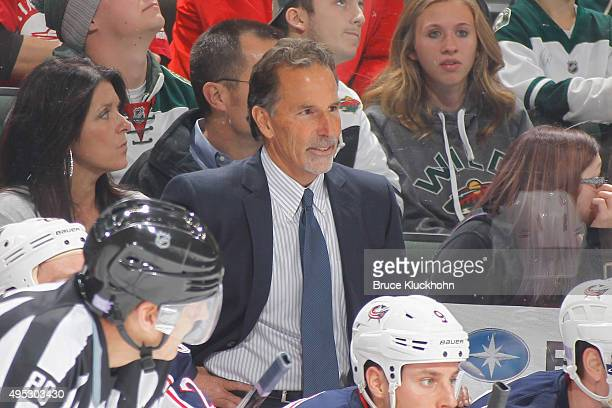 Columbus Blue Jackets JohnTortorella watches from the bench during the game against the Minnesota Wild on October 22 2015 at the Xcel Energy Center...