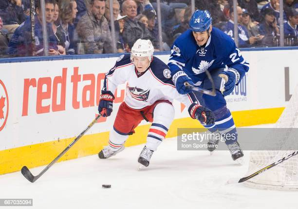 Columbus Blue Jackets left wing Matt Calvert battles for a puck with Toronto Maple Leafs center Brian Boyle during the third period in a game on...