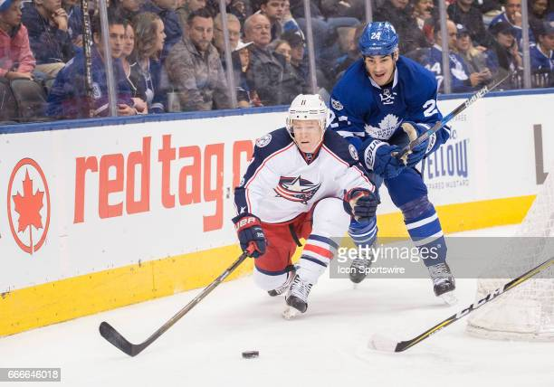 Columbus Blue Jackets left wing Matt Calvert battles with Toronto Maple Leafs center Brian Boyle during the third period in a game on April 9 at Air...