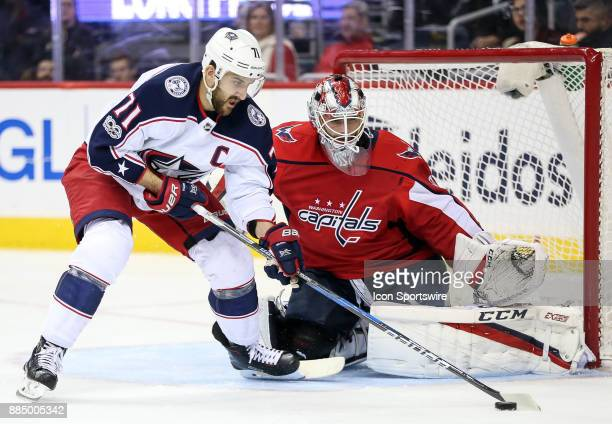 Columbus Blue Jackets left wing Nick Foligno has the puck in front of Washington Capitals goalie Braden Holtby during a NHL game between the...