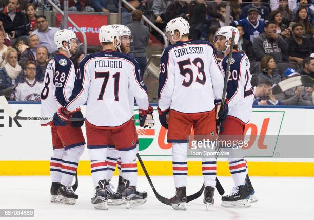 Columbus Blue Jackets left wing Nick Foligno talks with Columbus Blue Jackets right wing Oliver Bjorkstrand during a break in the first period in a...