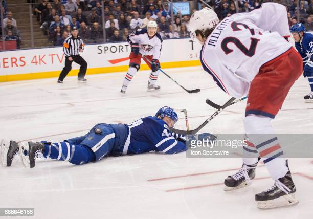 Columbus Blue Jackets left wing Sonny Milano shoots a puck by Toronto Maple Leafs defenseman Morgan Rielly during the third period in a game on April...