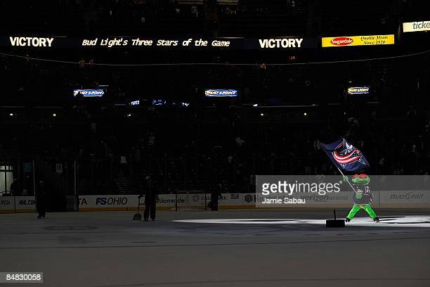 Columbus Blue Jackets mascot Stinger carries the flag after a 32 win over the Detroit Red Wings on February 13 2009 at Nationwide Arena in Columbus...