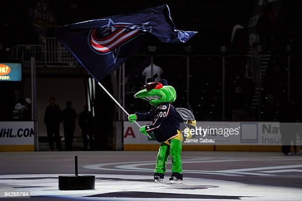 Columbus Blue Jackets mascot Stinger plants the victory flag at center ice after Columbus defeated the Florida Panthers 30 on December 9 2009 at...