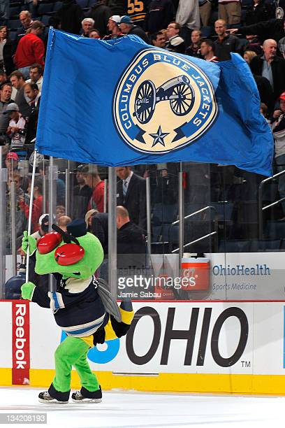 Columbus Blue Jackets mascot Stinger skates with a flag after the Blue Jackets defeated the Buffalo Sabres 51 on November 25 2011 at Nationwide Arena...