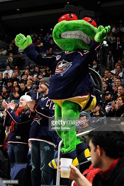 Columbus Blue Jackets mascot Stinger tries to get the crowd pumped up during a game between the San Jose Sharks and the Columbus Blue Jackets on...