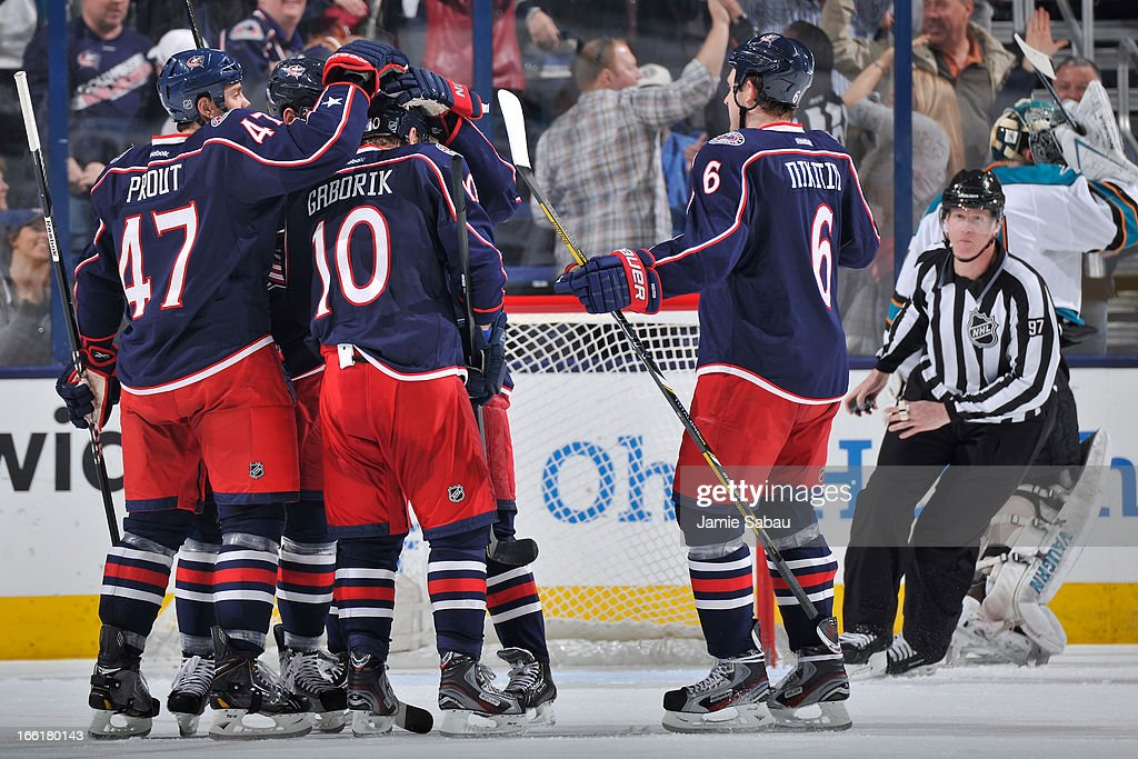 Columbus Blue Jackets players celebrate after scoring a goal against the San Jose Sharks during the second period on April 9, 2013 at Nationwide Arena in Columbus, Ohio.