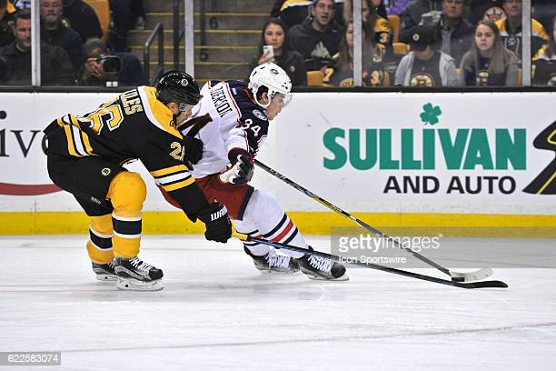 Columbus Blue Jackets Right Wing Josh Anderson beats Boston Bruins Defenceman JohnMichael Liles to the puck During the Columbus Blue Jackets game...