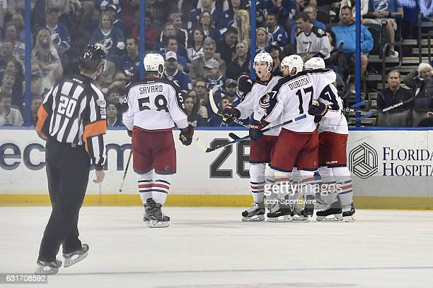 Columbus Blue Jackets right wing Josh Anderson celebrates a goal with teammates during the second period of an NHL game between the Tampa Bay...