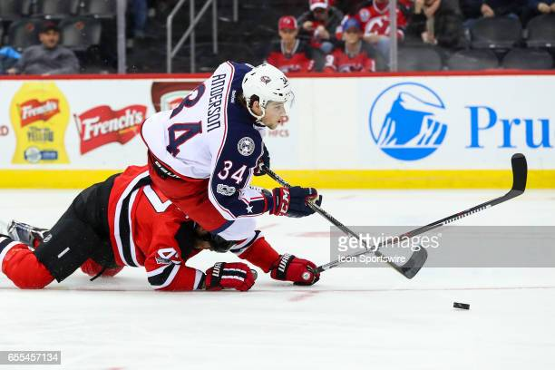 Columbus Blue Jackets right wing Josh Anderson is taken down by New Jersey Devils defenseman Dalton Prout and is awarded a penalty shot during the...