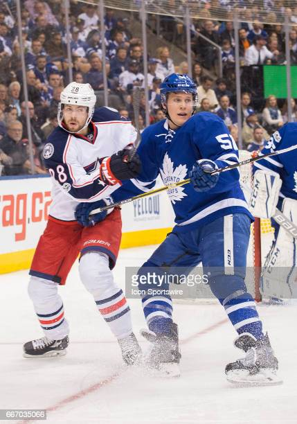 Columbus Blue Jackets right wing Oliver Bjorkstrand battles with Toronto Maple Leafs defenseman Jake Gardiner during the third period in a game on...