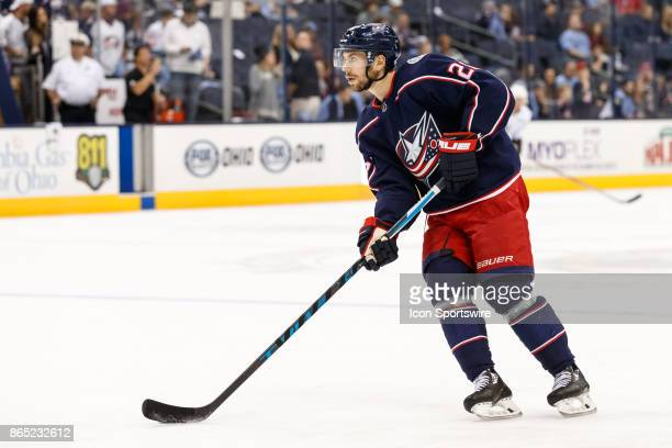 Columbus Blue Jackets right wing Oliver Bjorkstrand controls the puck during warmups before a game between the Columbus Blue Jackets and the Los...